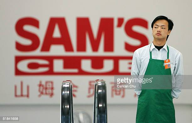 A worker goes up the escalator at Sam's club the first branch of a WalMart owned store in the capital on December 9 2004 in Beijing China The world's...