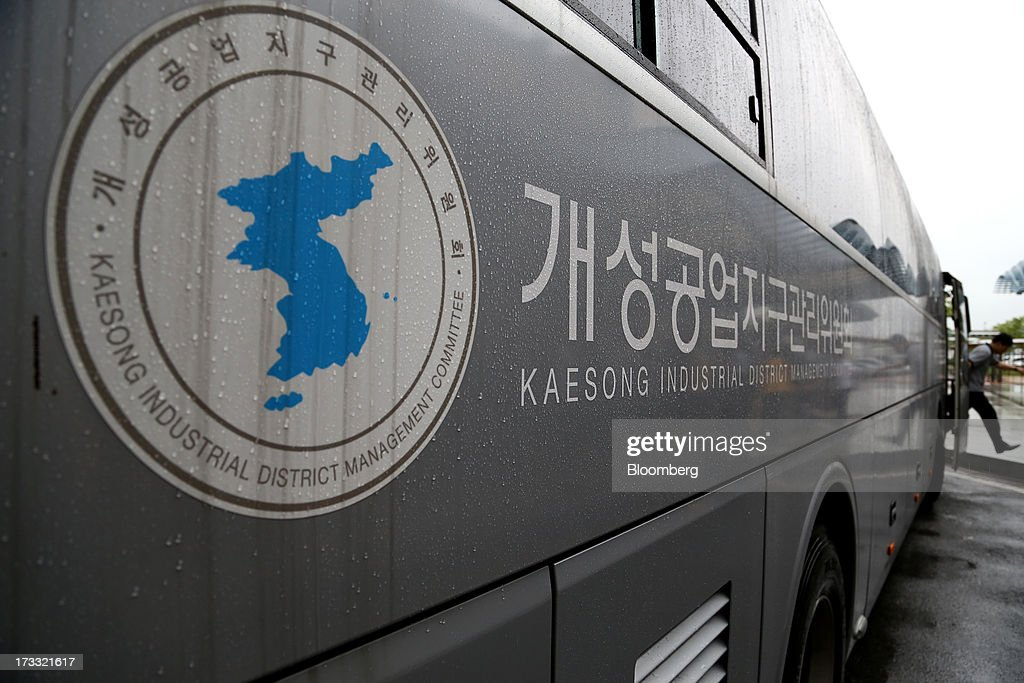 A worker going to the Gaeseong Industrial Complex exits a bus at the Customs, Immigration and Quarantine (CIQ) office near the demilitarized zone (DMZ) in Paju, South Korea, on Friday, July 11, 2013. North Korea notified South Korea today that it has deferred two separate sets of talks on the tours and the family reunions it proposed yesterday, and said it wants to focus on the ongoing dialog to reopen the joint Gaeseong industrial zone, the Souths Unification Ministry said in an e-mailed statement. The two sides yesterday decided to hold talks in Gaeseong on July 15, which will be their third round in one week, on normalizing operations in Gaeseong after the North unilaterally recalled its workers in April. Photographer: SeongJoon Cho/Bloomberg via Getty Images