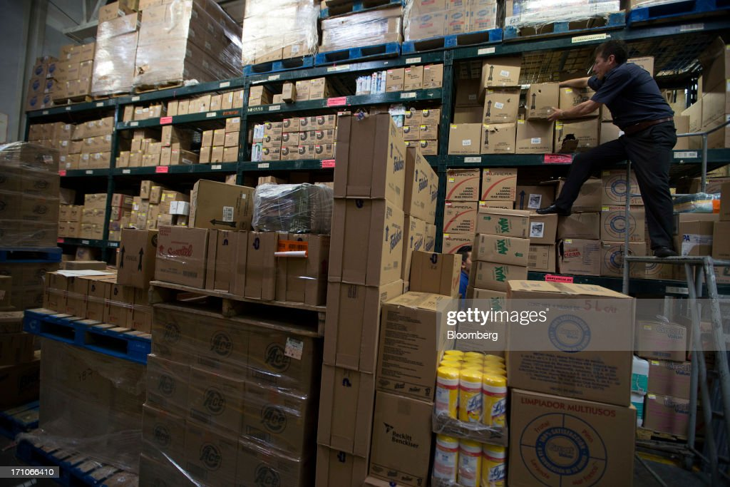 A worker grabs a box from shelf in the warehouse of a Wal-Mart Stores Inc. location in Mexico City, Mexico, on Thursday, June 20, 2013. Mexican retail sales rose 2.5 percent in April from the same month last year, the country's statistics agency, known as Inegi, reported on its website. Photographer: Susana Gonzalez/Bloomberg via Getty Images