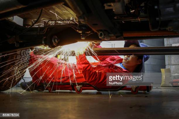 Worker grinding to auto folding foothold repair at mohenic garages in Paju South Korea A 20yearold beat up Hyundai SUV isn't anyone's idea of a dream...