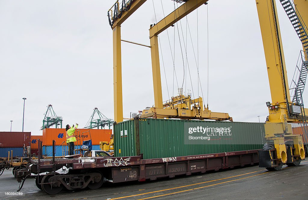 A worker guides a freight container being loaded onto a truck at the Port Of Halifax's Fairview Cove container terminal, operated by Cerescorp Co., in Halifax, Nova Scotia, Canada, on Wednesday, Jan. 30, 2013. Statistics Canada (STCA) is scheduled to release gross domestic product data on Jan. 31. Photographer: Aaron McKenzie Fraser/Bloomberg via Getty Images
