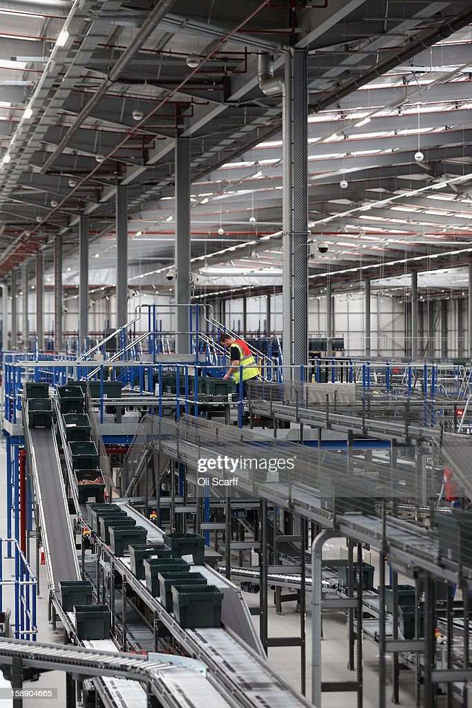 A worker handles an item in the giant semi-automated distribution centre where the company's partners process the online orders for the John Lewis department store on January 3, 2013 in Milton Keynes, England. John Lewis has published their sales report for the five weeks prior December 29, 2012 which showed online sales had increased by 44.3 per cent over the same period in 2011. Purchases from their website Johnlewis.com now account for one quarter of all John Lewis business.