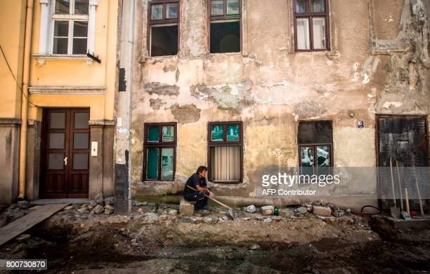 A worker has a break at a construction site in the center of the Serbian capital Belgrade on June 25 2017 as a heat wave sweeps the country with...