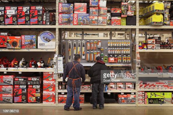 A worker helps a customer in the garden center at a Home Depot store on February 15 2011 in Chicago Illinois Home Depot said today it will hire more...