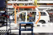 A worker helps builds a Chrysler Minivan on the assembly line at the Chrysler Windsor Assembly plant January 18 2011 in Windsor Ontario Canada...