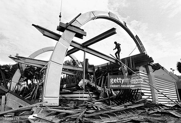 A worker helps demolish a 1950s era McDonald's fast food drivein restaurant located along US 1 in Daytona Beach Florida 5104602RA_Florida145jpg