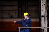 A worker helps set up for the arrival of US President Barack Obama at ArcelorMittal the world's largest steel company November 14 2013 in Cleveland...
