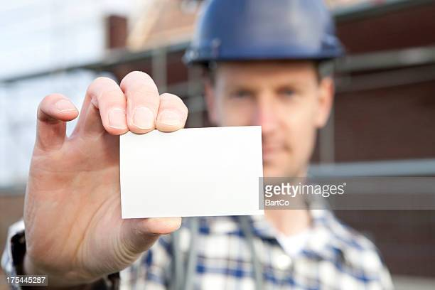 Worker Holding a Blank Business Card