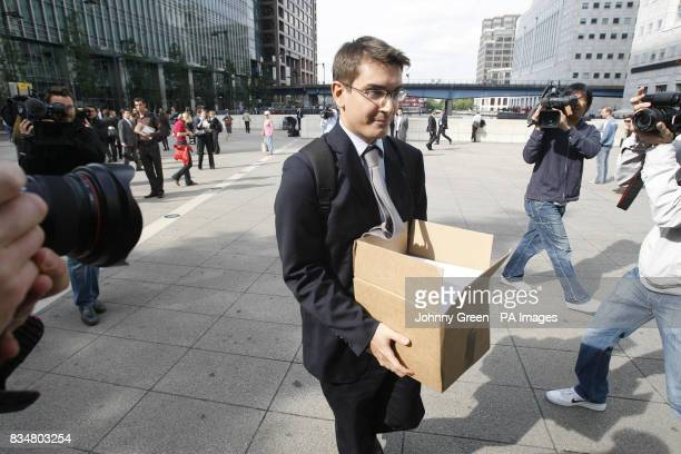 A worker holding a box leaves the Lehman Brothers headquarters at Canary Wharf in London Lehman Brothers a top US investment bank has filed for...