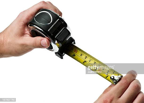 Worker holding a retractable tape measure
