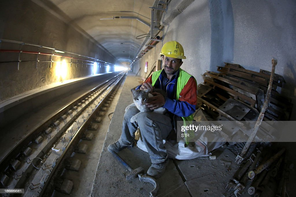 A worker holds a cat in the Marmaray Tunnel under the Bosphorus on April 18 in Istanbul Marmaray is a rail transport project in Istanbul It consists...