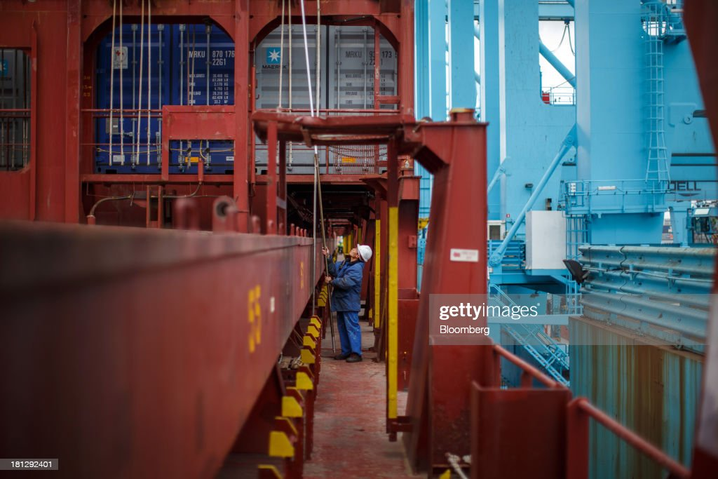 A worker holds a poll on board the container ship Maersk Seoul, operated by AP Moeller-Maersk A/S, as cargo is unloaded at the APM Terminal in the Port of Rotterdam, in Rotterdam, Netherlands, on Thursday, Sept. 19, 2013. The pace of economic contraction in the Netherlands, which is in its third recession in five years, is slowing. Photographer: Jasper Juinen/Bloomberg via Getty Images