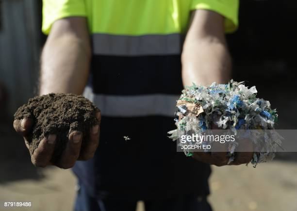 A worker holds the final product of treated waste at a waste treatment plant in the area of Monteverde east of Beirut on October 27 2017 The Lebanese...