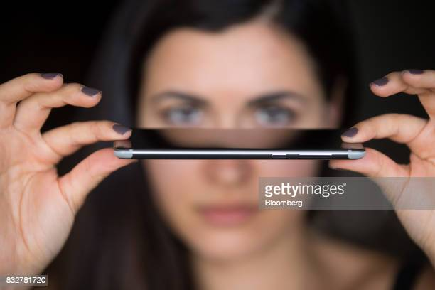 A worker holds the Nokia 8 smartphone designed by HMD Global Oy ahead of its official unveiling in London UK on Tuesday Aug 15 2017 The phone will...