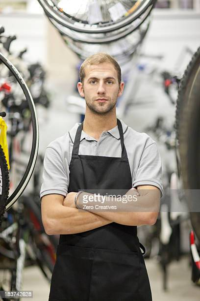 Worker in bicycle shop
