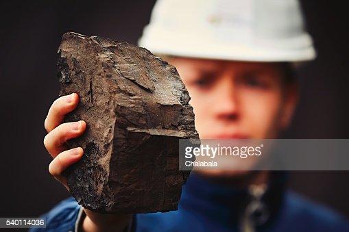 Worker in coal mine : Stock Photo