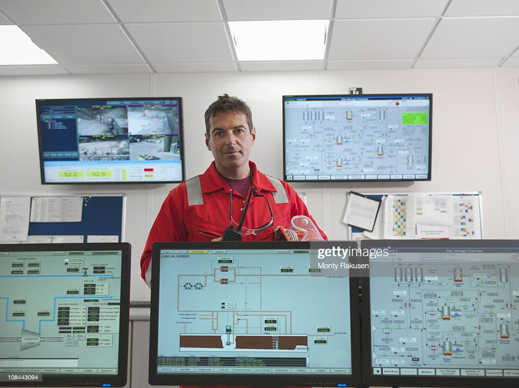 Worker in control room of gas plant