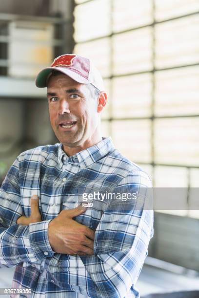 Worker in garage wearing trucker's hat