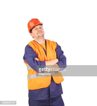 Worker in hard hat and vest. : Stock Photo