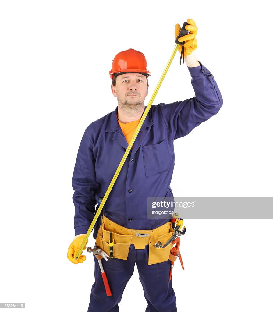 Worker in hard hat with ruler. : Stock Photo