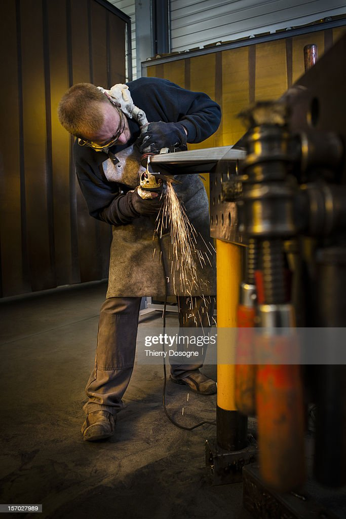 Worker in metal worshop : Stock Photo