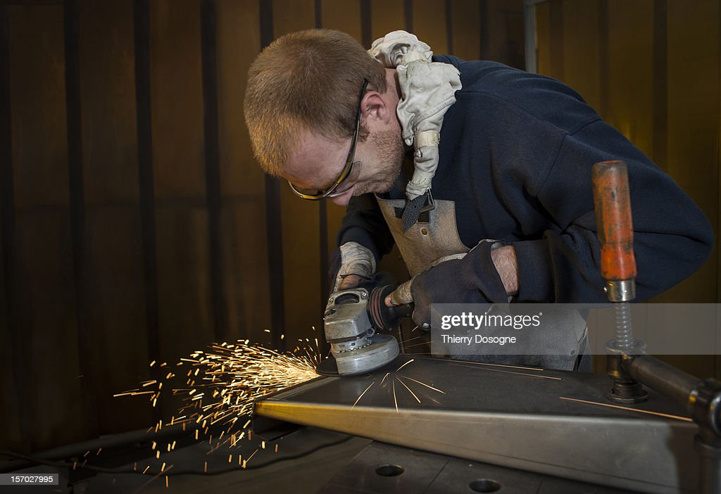 Worker in metal worshop : Stock Photo