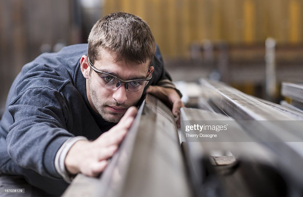 Worker in metal worshop