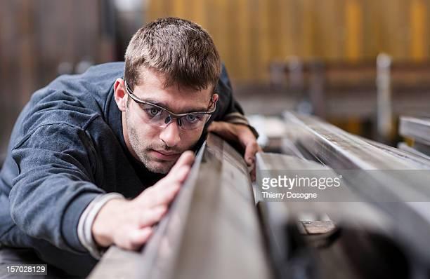 Worker in metal worshop
