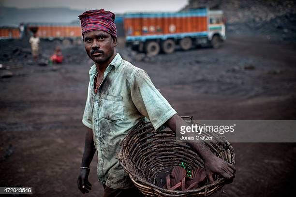 A worker in the Jharia coal mines Jharia in India's eastern Jharkand state is literally in flames This is due to the open cast coal mining that takes...