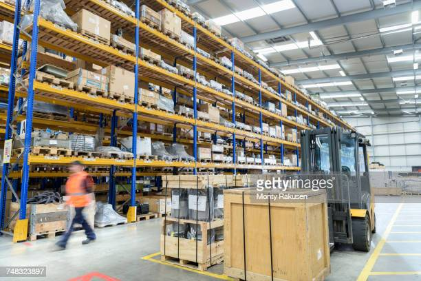 Worker in warehouse in train works