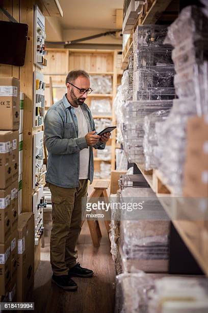Worker in Warehouse with digital tablet