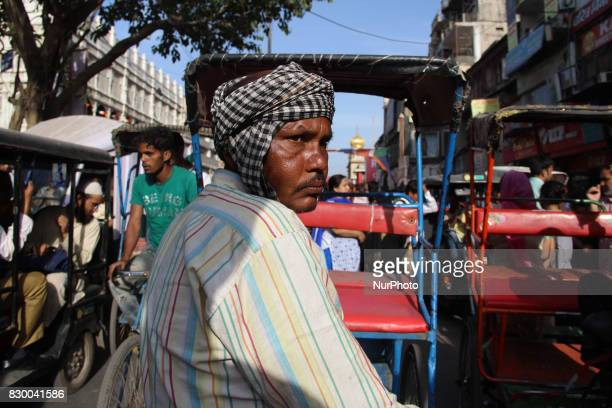 A worker Indian rickshaws in Old Delhi India on 11 August 2017 The Traditional Rickshaws is one of the least expensive mode of transport Ideal for...