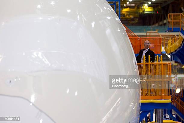A worker inspects a Boeing Co 787 Dreamliner airplane at the Boeing Everett Factory in Everett Washington US on Wednesday May 29 2013 Boeing Co...
