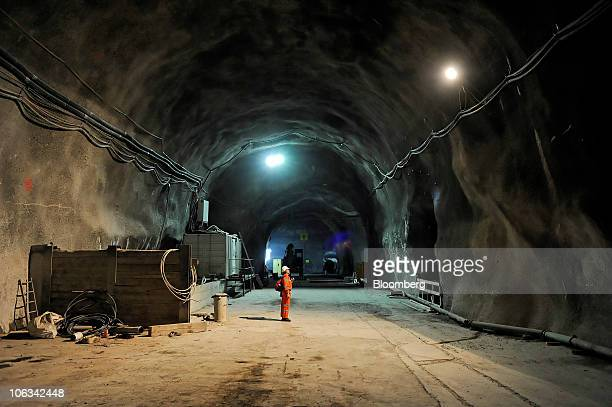 A worker inspects a wall in the Gotthard railway tunnel in Erstfeld Switzerland on Wednesday Oct 27 2010 When completed the tunnel will be the...