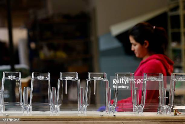 A worker inspects acrylic blender jars at the KTec Inc Blendtec factory in Orem Utah US on Wednesday March 26 2014 The Institute for Supply...