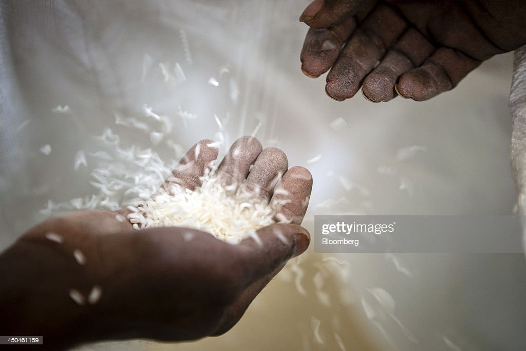 A worker inspects rice as it goes through a polishing machine at the KRK Modern Rice Mill in Kothepata, Tamil Nadu, India, on Thursday, Nov. 14, 2013. Record onion prices and the soaring cost of rice and coriander are frustrating Reserve Bank of India Governor Raghuram Rajans battle to curb inflation while supporting growth in Asias third-largest economy. Photographer: Prashanth Vishwanathan/Bloomberg via Getty Images