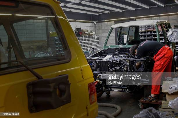 Worker install electric cable at mohenic garages in Paju South Korea A 20yearold beat up Hyundai SUV isn't anyone's idea of a dream car But used...