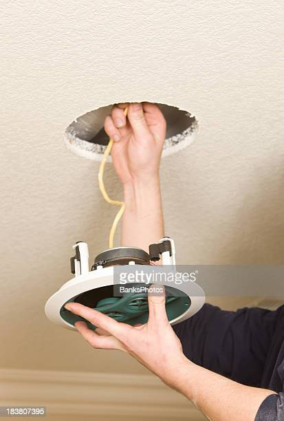 Worker Installing a Residential Ceiling Speaker