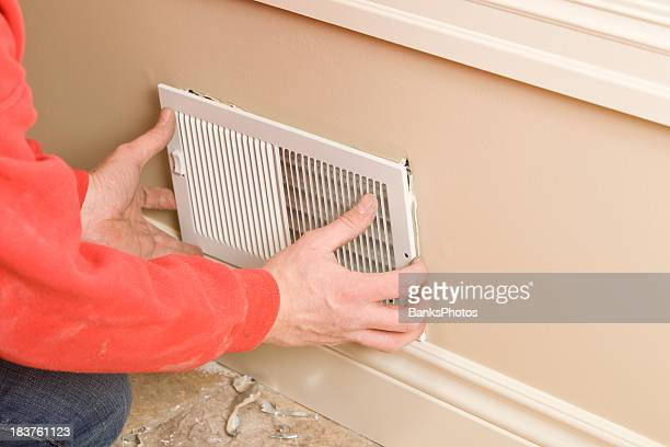 HVAC Worker Installing Residential Room Vent