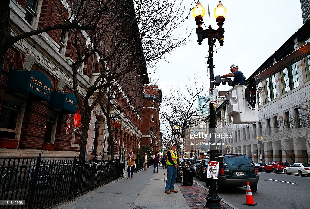 A worker installs a security camera along Boylston Street prior to the one year anniversary of the Boston Marathon bombing on April 14, 2014 in Boston, Massachusetts. Last year, two pressure cooker bombs killed three and injured an estimated 264 others during the Boston marathon, on April 15, 2013.