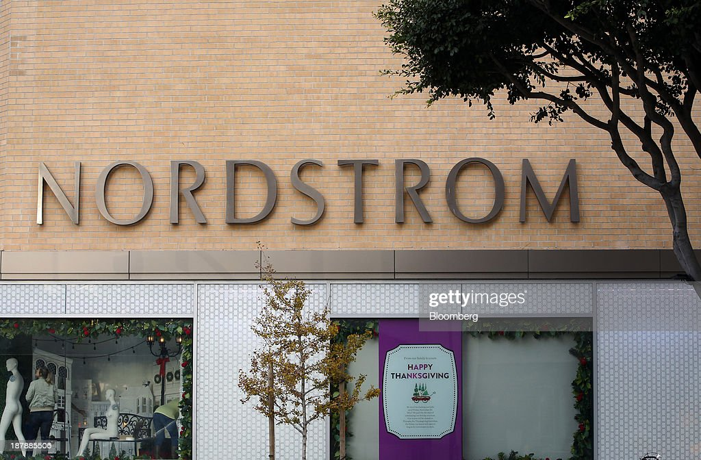 A worker installs a window display in preparation for the holiday shopping season at a Nordstrom Inc. department store in Santa Monica, California, U.S., on Tuesday, Nov. 12, 2013. Nordstrom Inc. is scheduled to release earnings figures on Nov. 14. Photographer: Patrick T. Fallon/Bloomberg via Getty Images