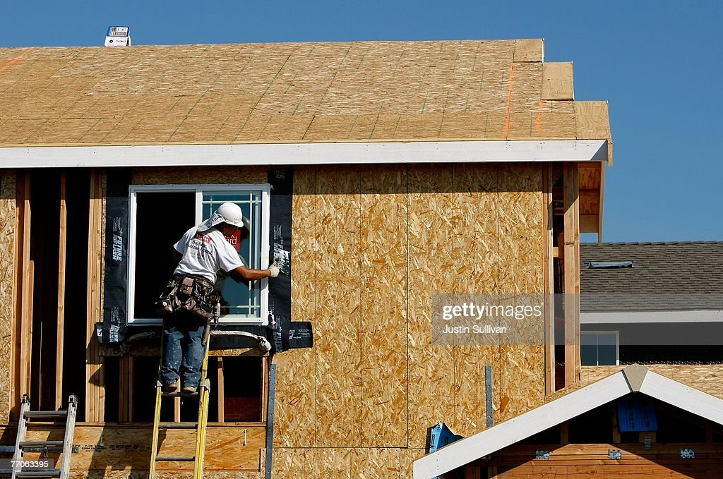 A worker installs a window in a new home under construction at a housing development September 27, 2007 in Richmond, California.Tthe Commerce Department reported today that sales of new homes fell 8.3 percent in August, bringing sales to an annual rate of 795,000 units, the lowest level since June 2007.