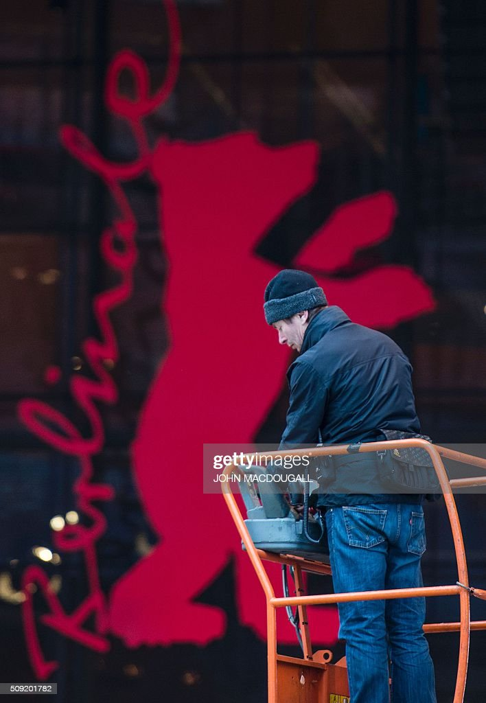 A worker installs audio equipment in front of the Berlinale Film Festival's main venue, the Berlinale Palast, in Berlin on February 9, 2016. Movies starring Colin Firth, Kirsten Dunst and Emma Thompson will vie for gold at the 66th Berlin film festival starting February 11, with Meryl Streep as jury president and a spotlight on Europe's refugee crisis. / AFP / John MACDOUGALL