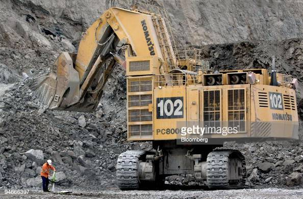 A worker is pictured beside an earthmoving truck at the Kalgoorlie Consolidated Gold Mine in Kalgoorlie Western Australia on Thursday July 6 2006 The...