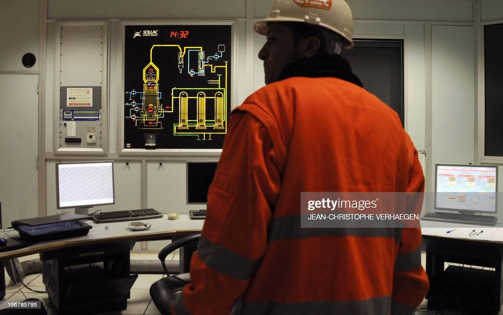 A worker is pictured in a control room at the blast furnaces of steel giant ArcelorMittal in Hayange part of the Florange site, eastern France, on November 20, 2012. ArcelorMittal's management said on November 19, 2012 that the 'situation is even more sluggish in 2013 than in 2012' for some of its activities during an Extraordinary Central Works Council which concluded without providing informations about potential buyers. AFP PHOTO / JEAN-CHRISTOPHE VERHAEGEN