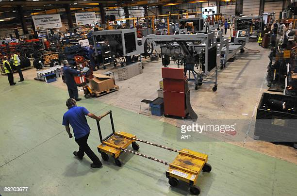 A worker is pictured inside an Alexander Dennis factory in Guildford Surrey on July 15 2009 Alexander Dennis are the manufacturers of a fleet of new...