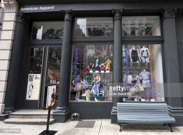 Worker is prerformed in an American Apparel store window in lower Manhattan August 18 2010 in New York The stock of the trendy Los Angeles clothing...