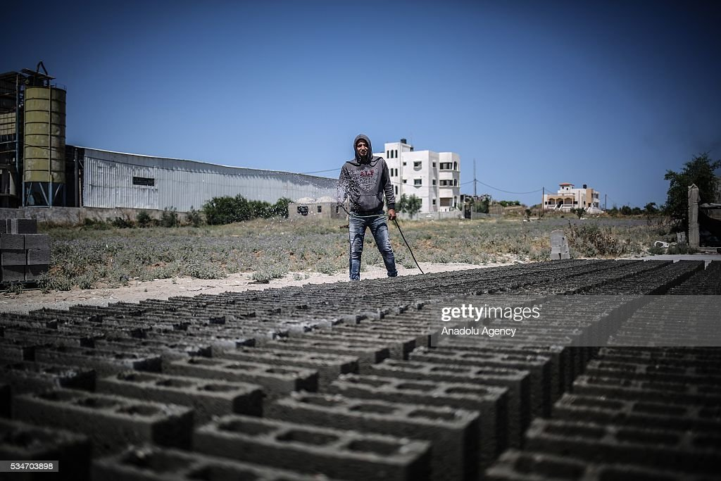 A worker is seen at a concrete brick factory, restarting to manufacture after Israel allowed building materials' passing from Karim Abu Salim border gate in Gaza City, Gaza on May 25, 2016.