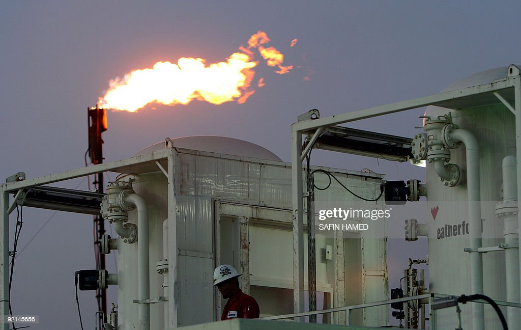 A worker is seen at an oil refinery near the village of Taq Taq in the autonomous Iraqi region of Kurdistan on May 31 2009 Iraq's selfruled Kurdish...