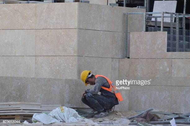 A worker is seen at the construction site of Turkey's biggest retractableroof shopping mall which will be opened in September in Ankara Turkey on...